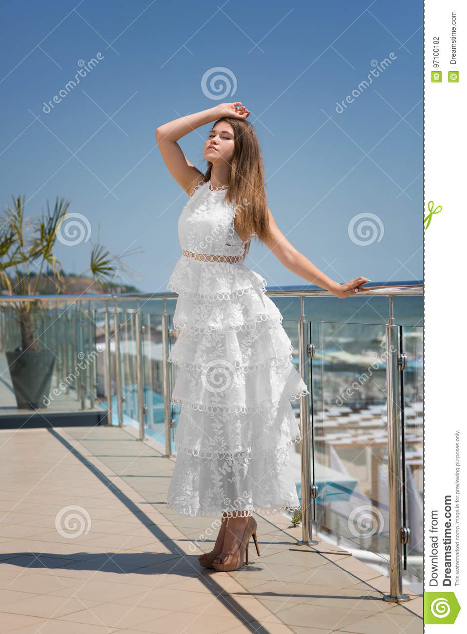 A Lady In Long, White Dress And On High Heels On A Hotel`s Balcony ...