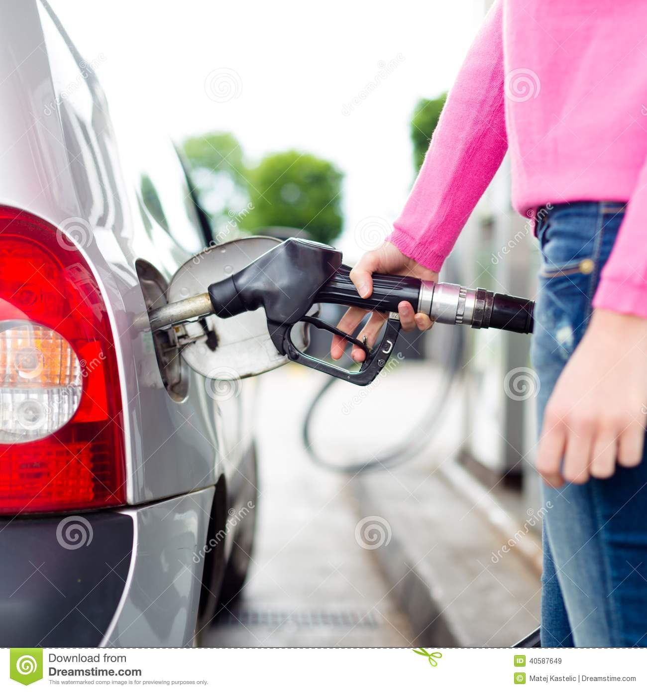 Lady pumping gasoline fuel in car at gas station stock for Max motor dreams cost