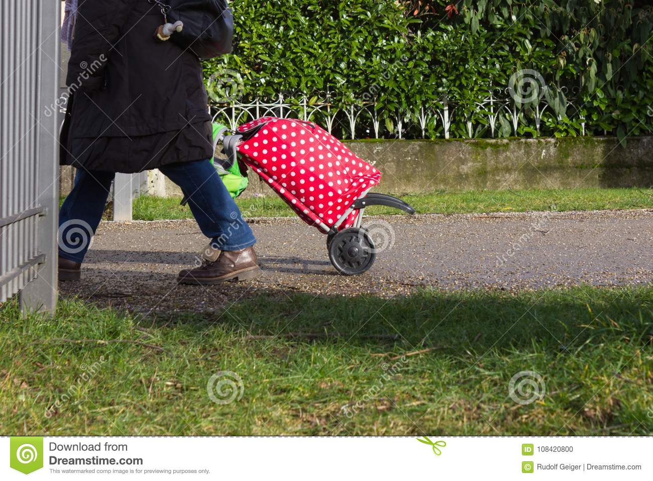 lady with red trolley