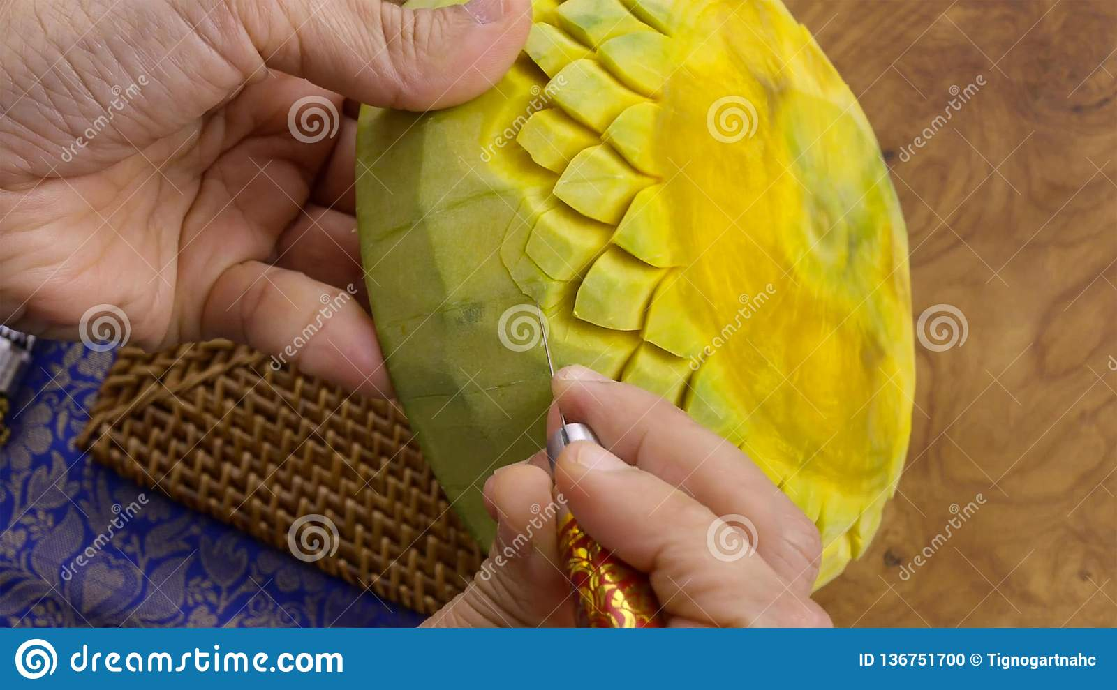 Lady`s hand crafting pumpkin in a floral pattern. Thai style