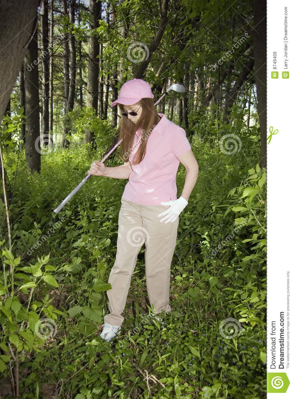 Lady Searching For Lost Golf Ball Royalty Free Stock