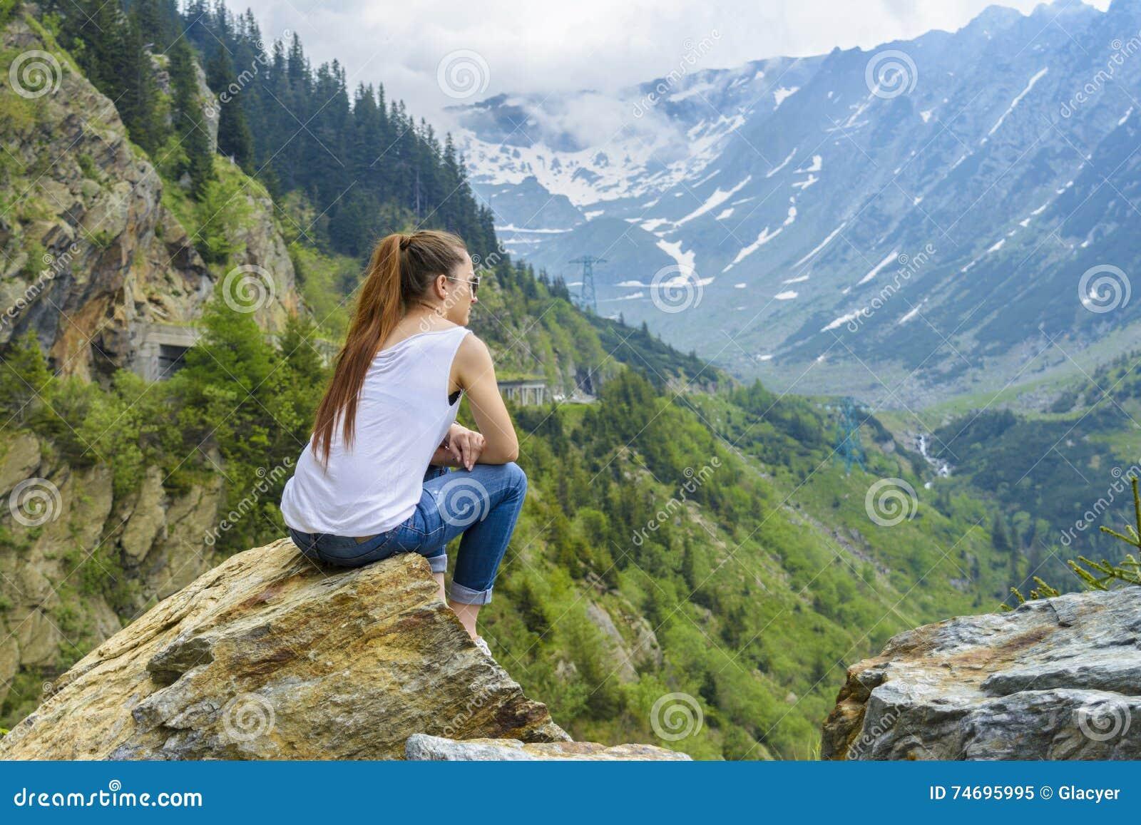 Lady tourist on mountain