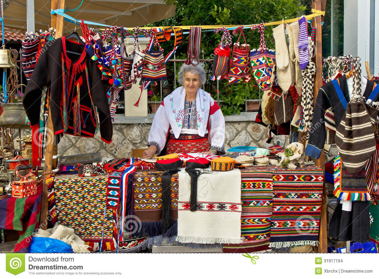 Lady In Traditional Clothes Selling On Booth Editorial