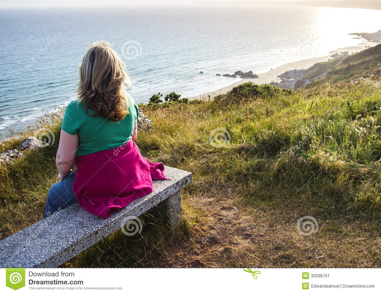 Lady Walker On Bench Gazing Out To Sea Stock Image