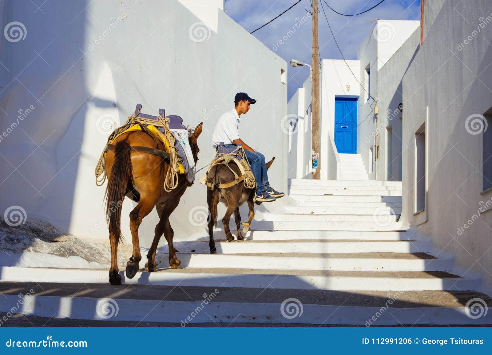 Lagada of Amorgos,Greece-August 2 ,2017.A small kid riding his d