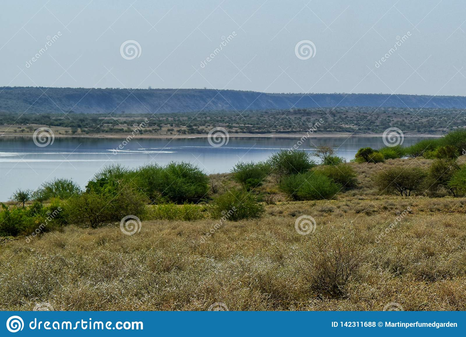 Lake against an arid landscape
