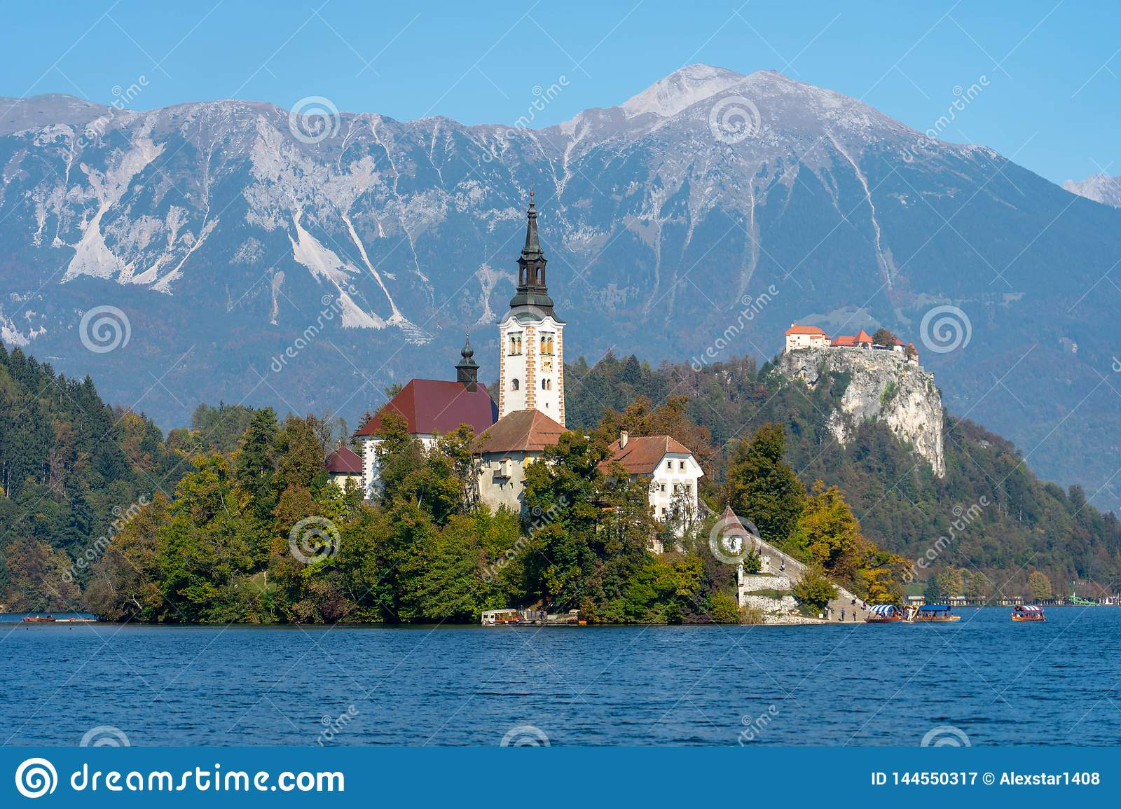 Lake Bled island with mountains in the background