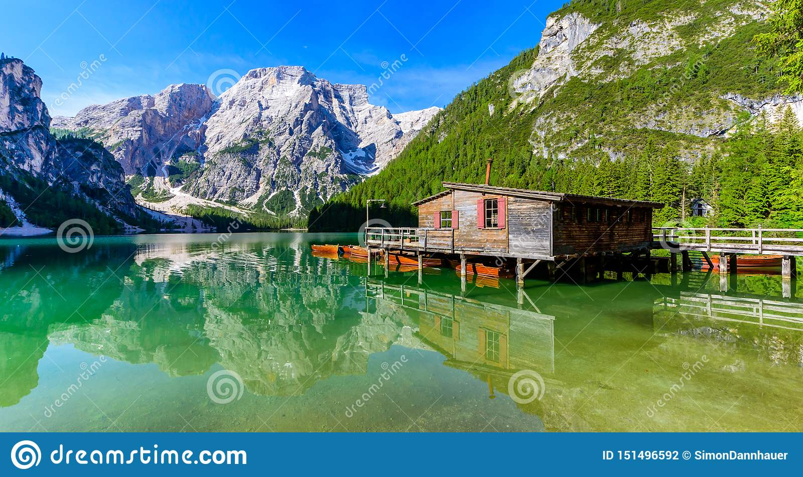 Lake Braies also known as Pragser Wildsee  in beautiful mountain landscape. Relaxing and recreation at Lago di Braies in Dolomites