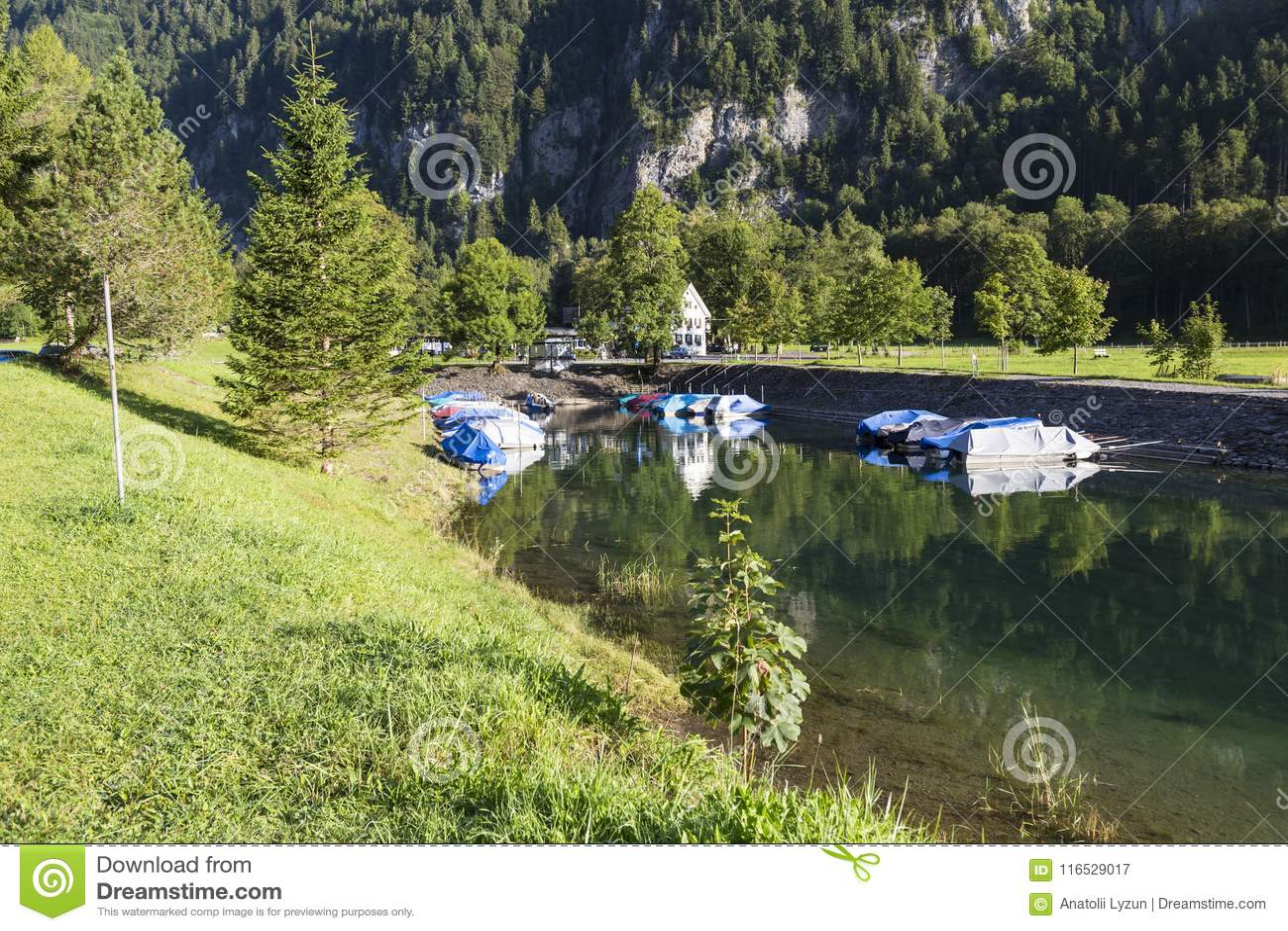 Lake Klontalersee Boats On The Dock Summer In Switzerland Stock