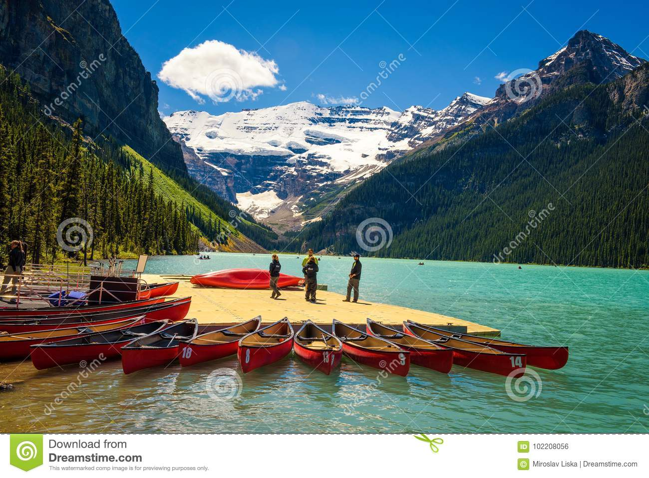 Canoes on a jetty at Lake Louise in Banff National Park, Canada