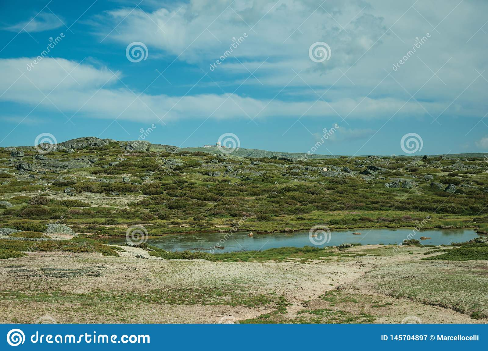 Lake on rocky landscape with domes of an old radar station