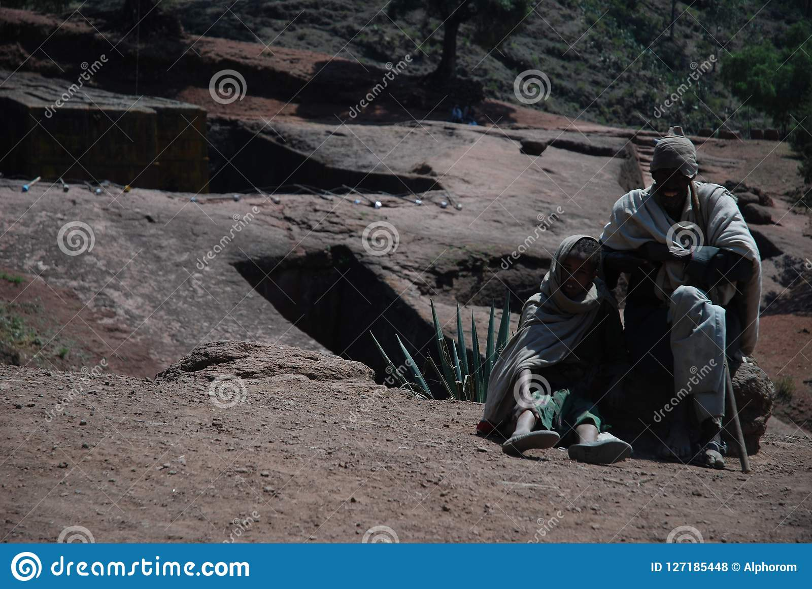 Lalibela, Wollo, Ethiopia, circa February 2007: Pilgrims outside of rock hewn church of Saint George, or Bet Giyorgis
