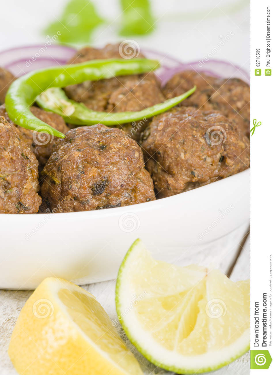 Kofta - South Asian spicy meatballs garnished with green chilies and ...