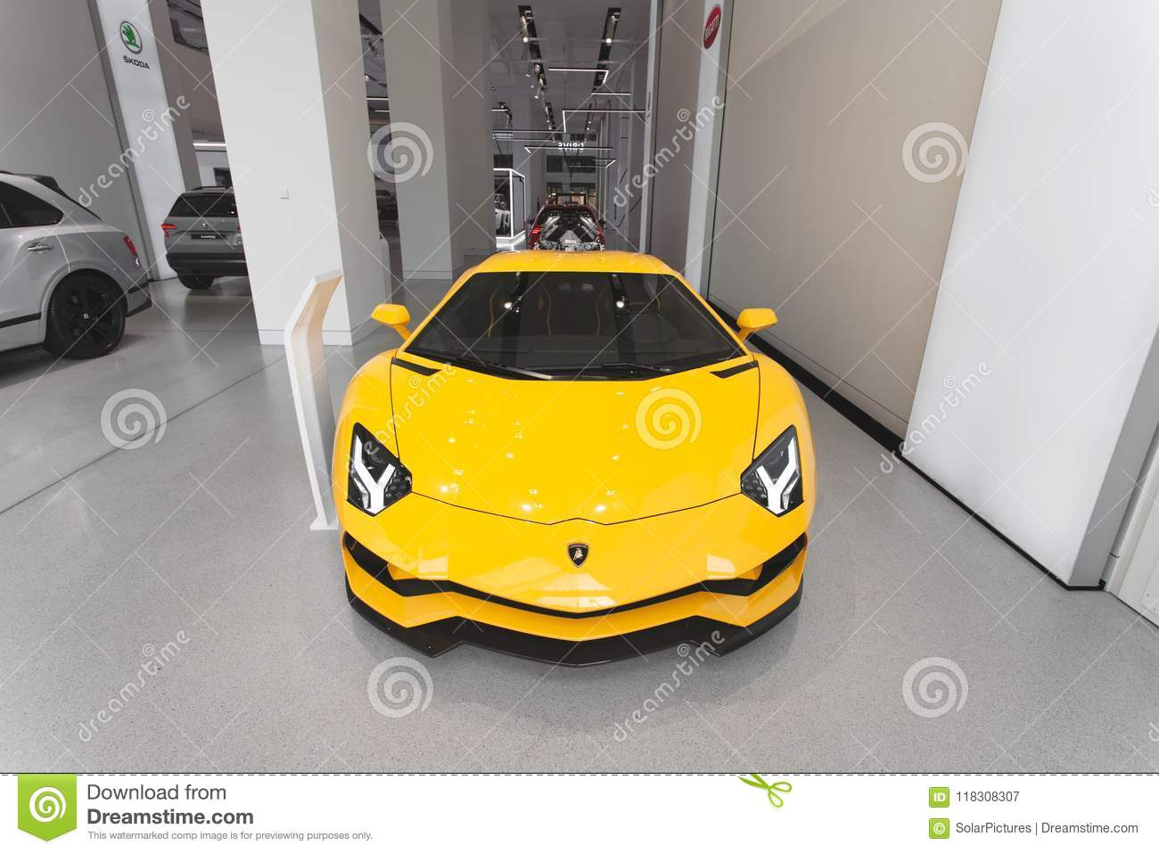 Lamborghini Aventador In Yellow In A Showroom Front Perspective