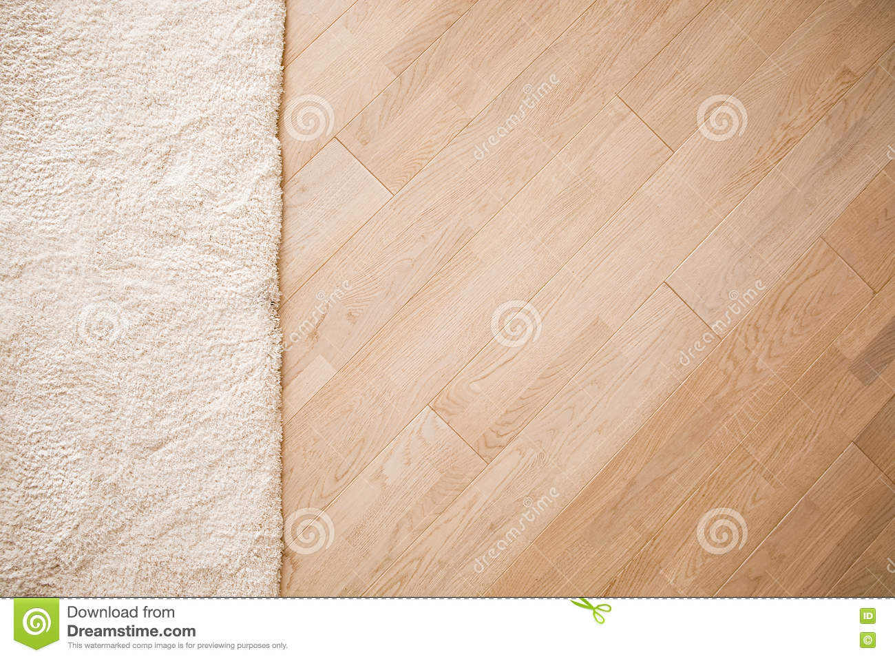 Laminate parquete floor with beige soft carpet