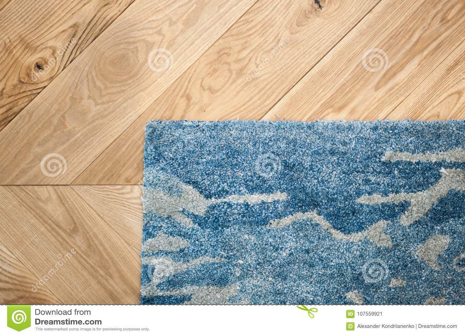 Laminate parquete floor. Light wooden texture. Beige soft carpet. Warm interior design.