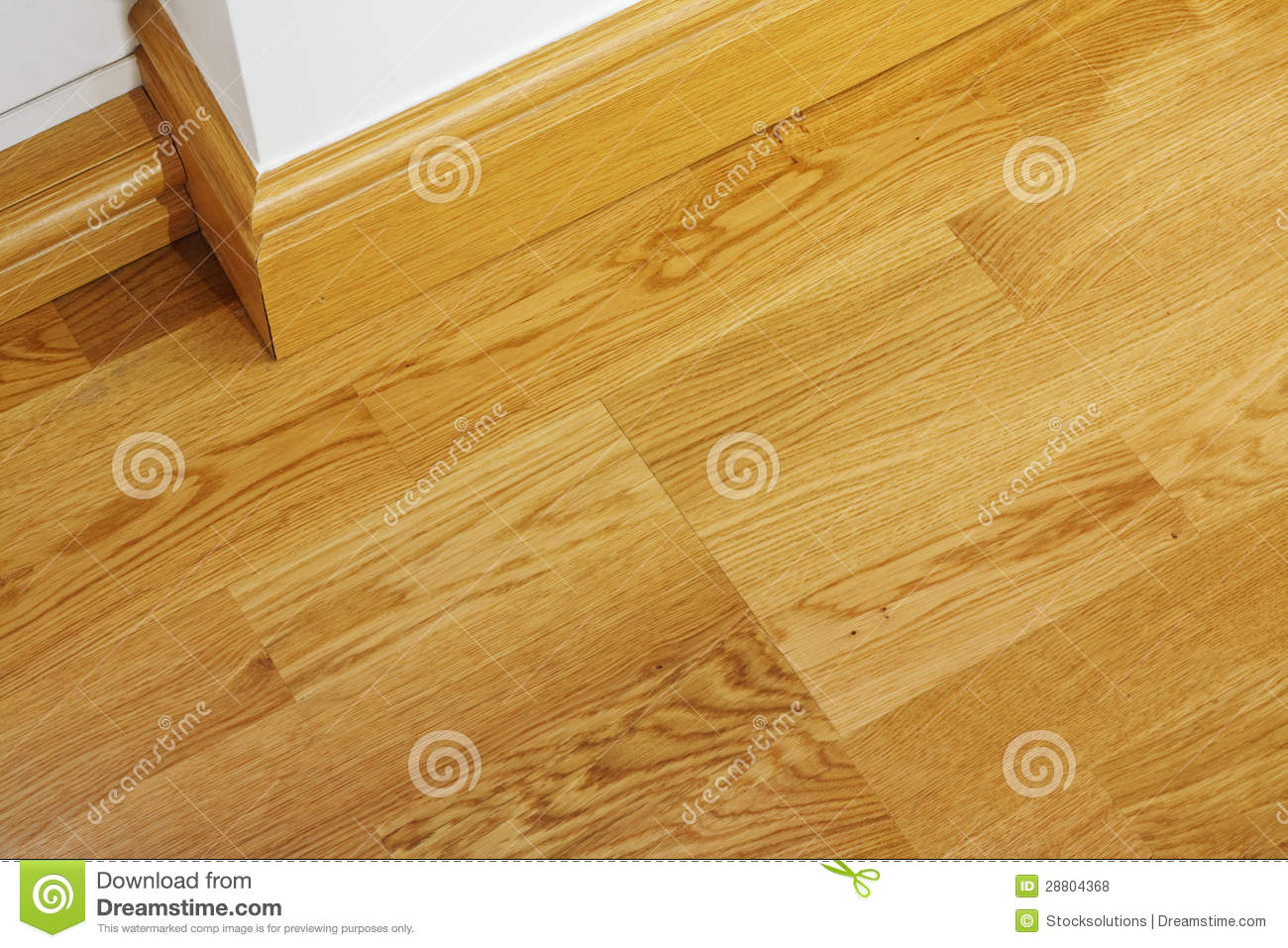 Laminate Wooden Flooring And Skirting Boards Stock Photo