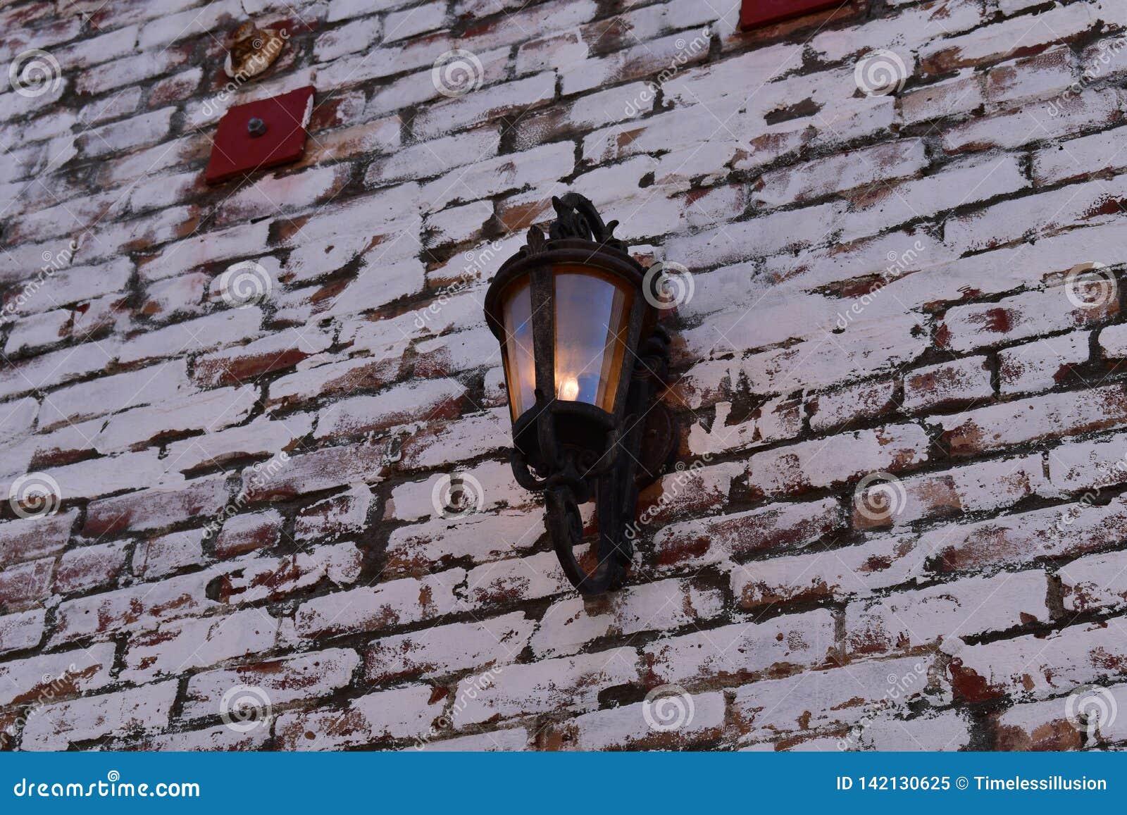 Lamp on a brick wall