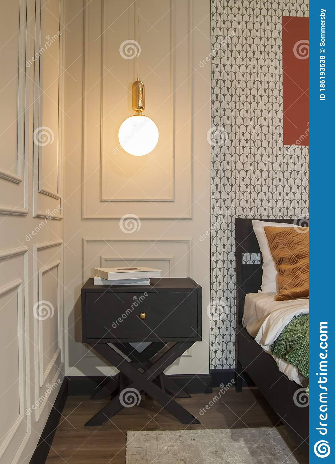 Lamp Hangs Over The Bedside Table And A Bed With Decorative Pillows And A Wooden Headboard In The Bedroom In The Apartment Stock Photo Image Of Lifestyle Cozy 186193538