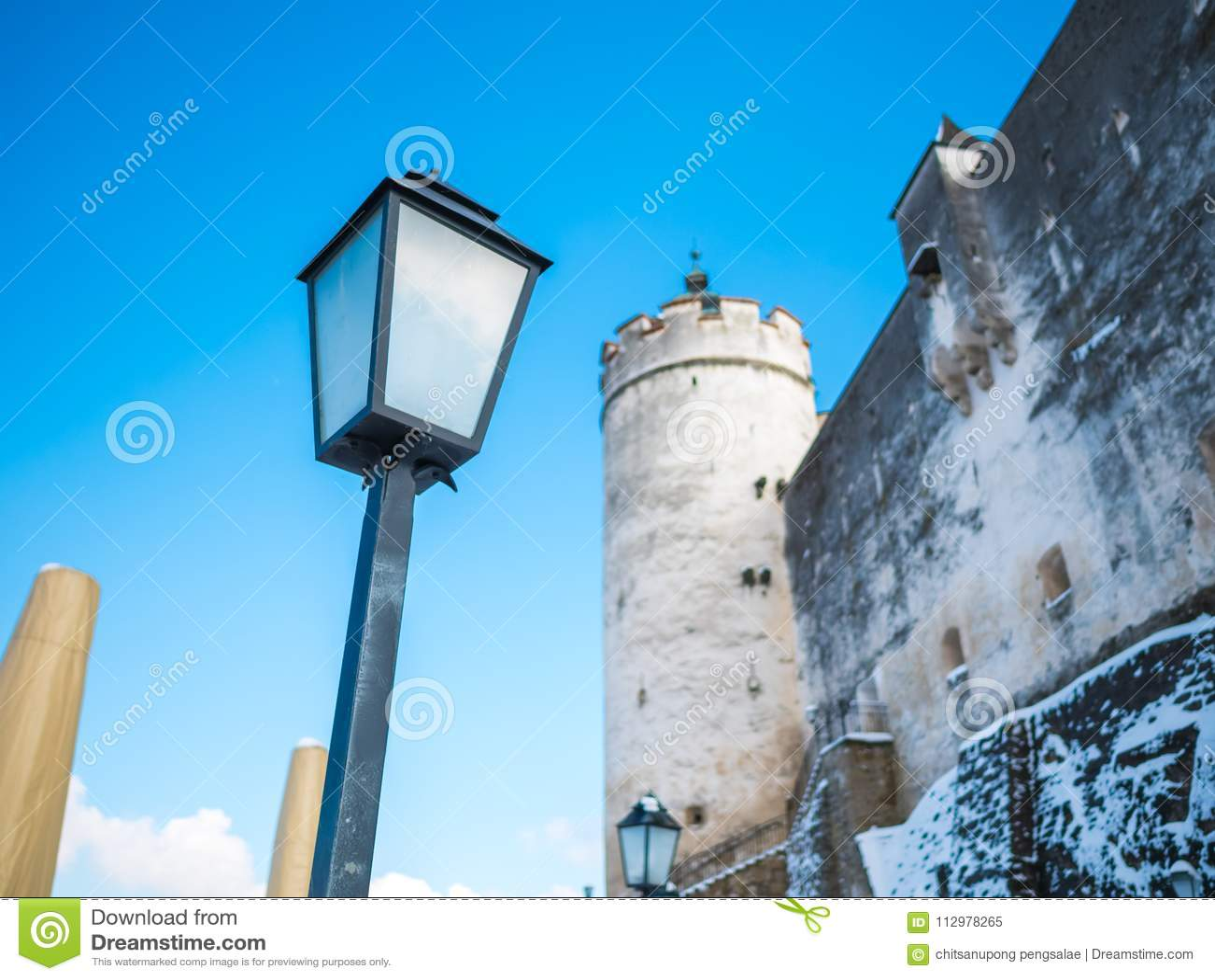 Lamp light fortress castle blue sky salzburg austria winter snow
