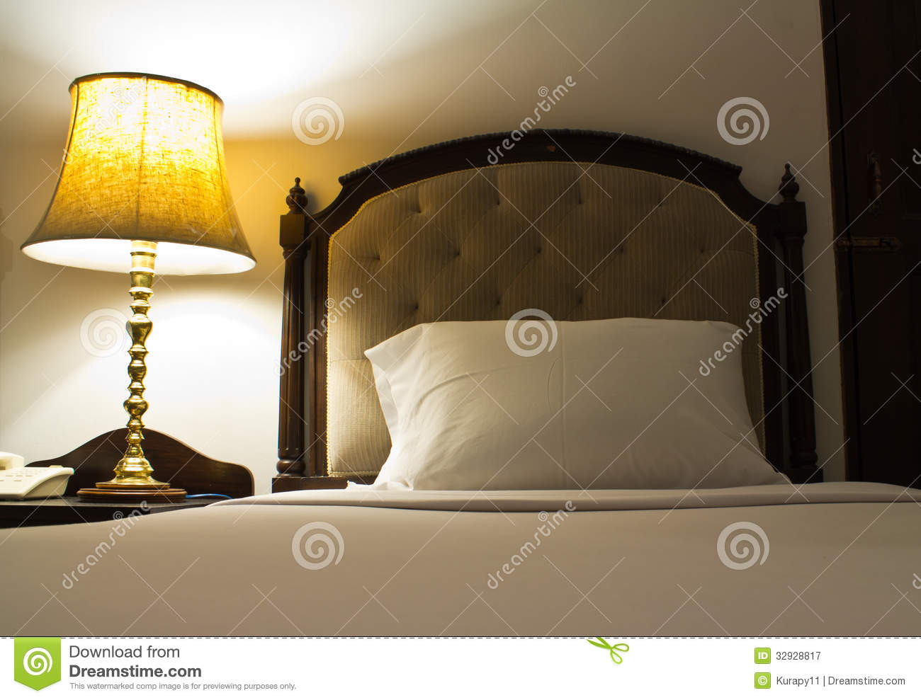 l on a night table next to a bed royalty free stock
