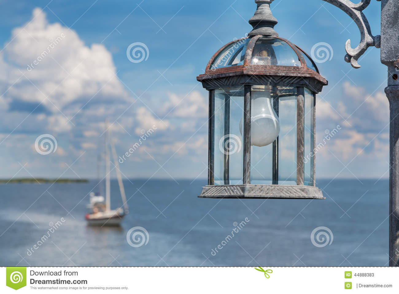 Lamp post with light bulb by the ocean stock image image of lamp post with light bulb by the ocean aloadofball Choice Image