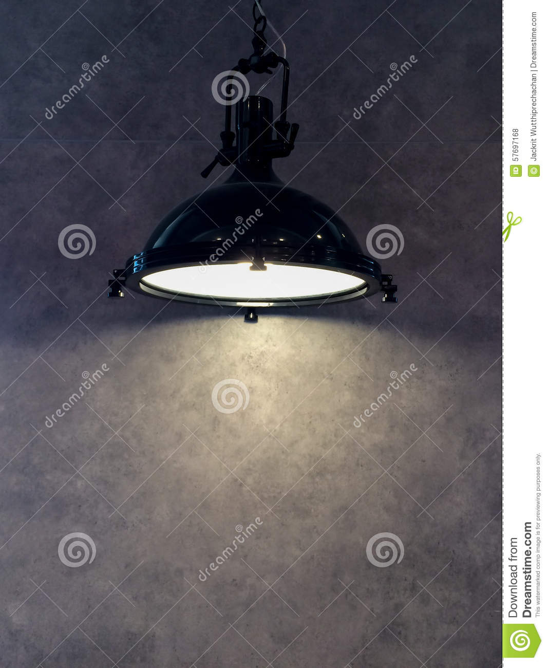 lamp shade from modern black metal lamp hanging on gray wall