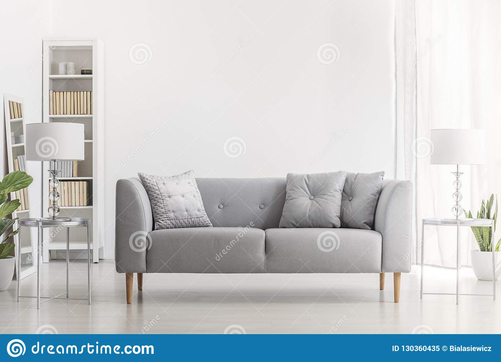 Marvelous Lamp On Silver Table Next To Grey Sofa With Pillows In White Uwap Interior Chair Design Uwaporg