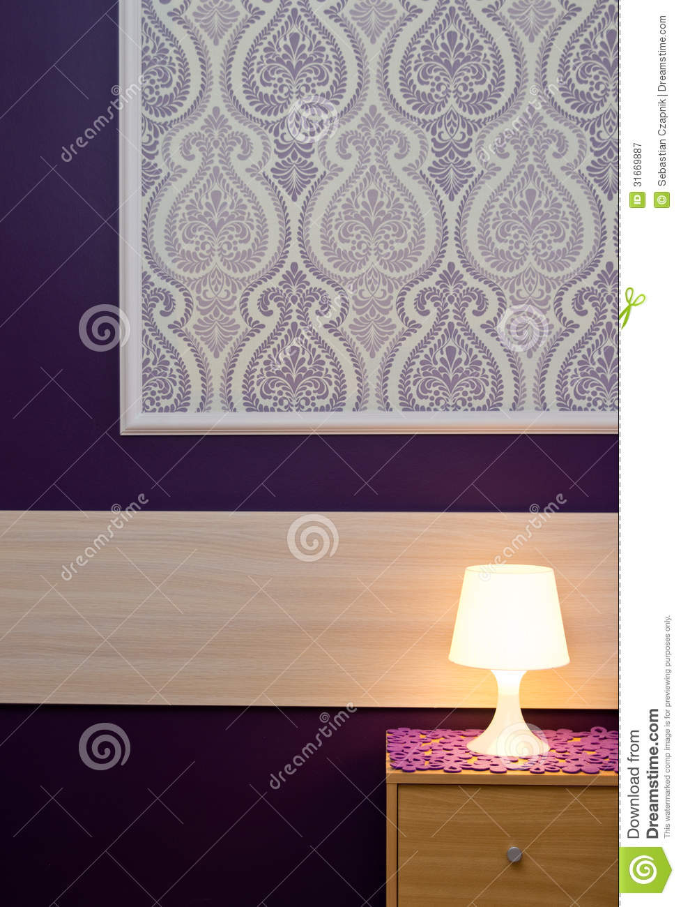 A lamp with violet wallpaper