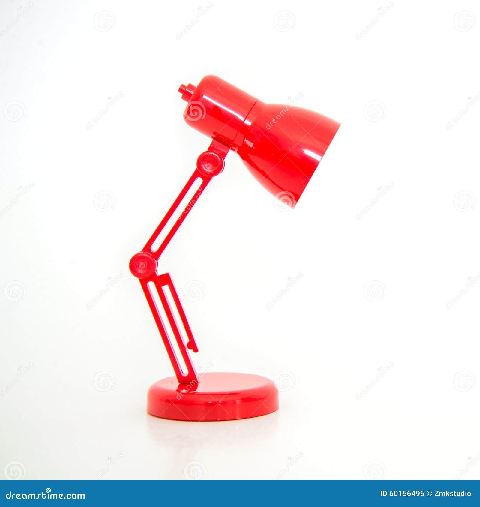 Lampe de bureau moderne de couleur rouge sur le fond blanc