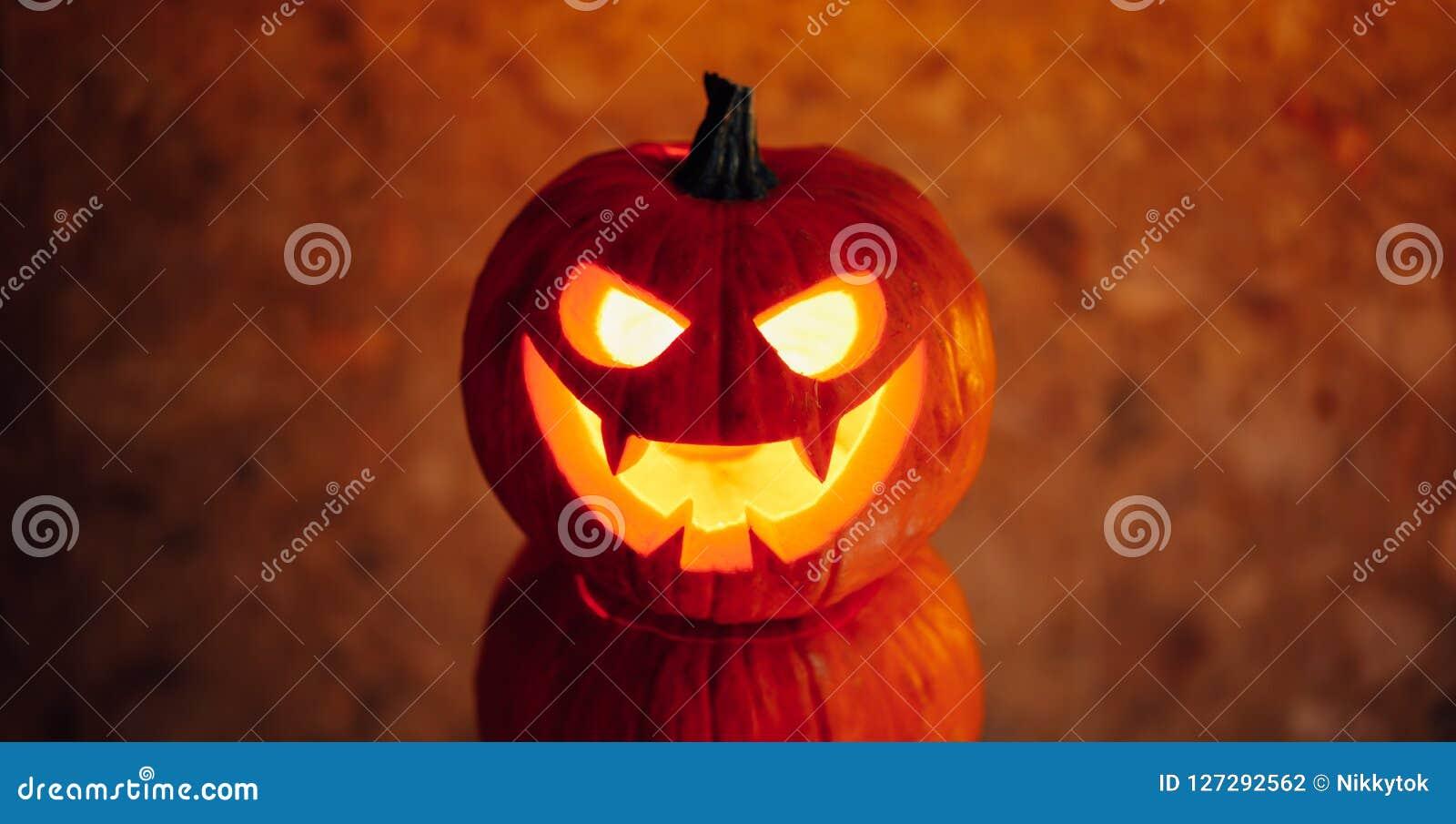 Lampionu dyniowy pomarańczowy światło, Halloweenowy tło