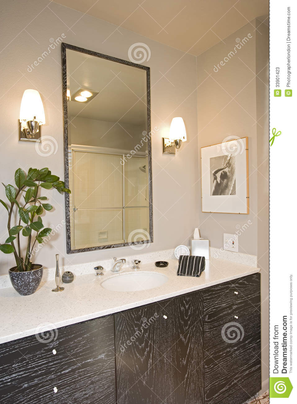 Lamps By Mirror Over Washbasin In Bathroom Stock Image - Image of ...