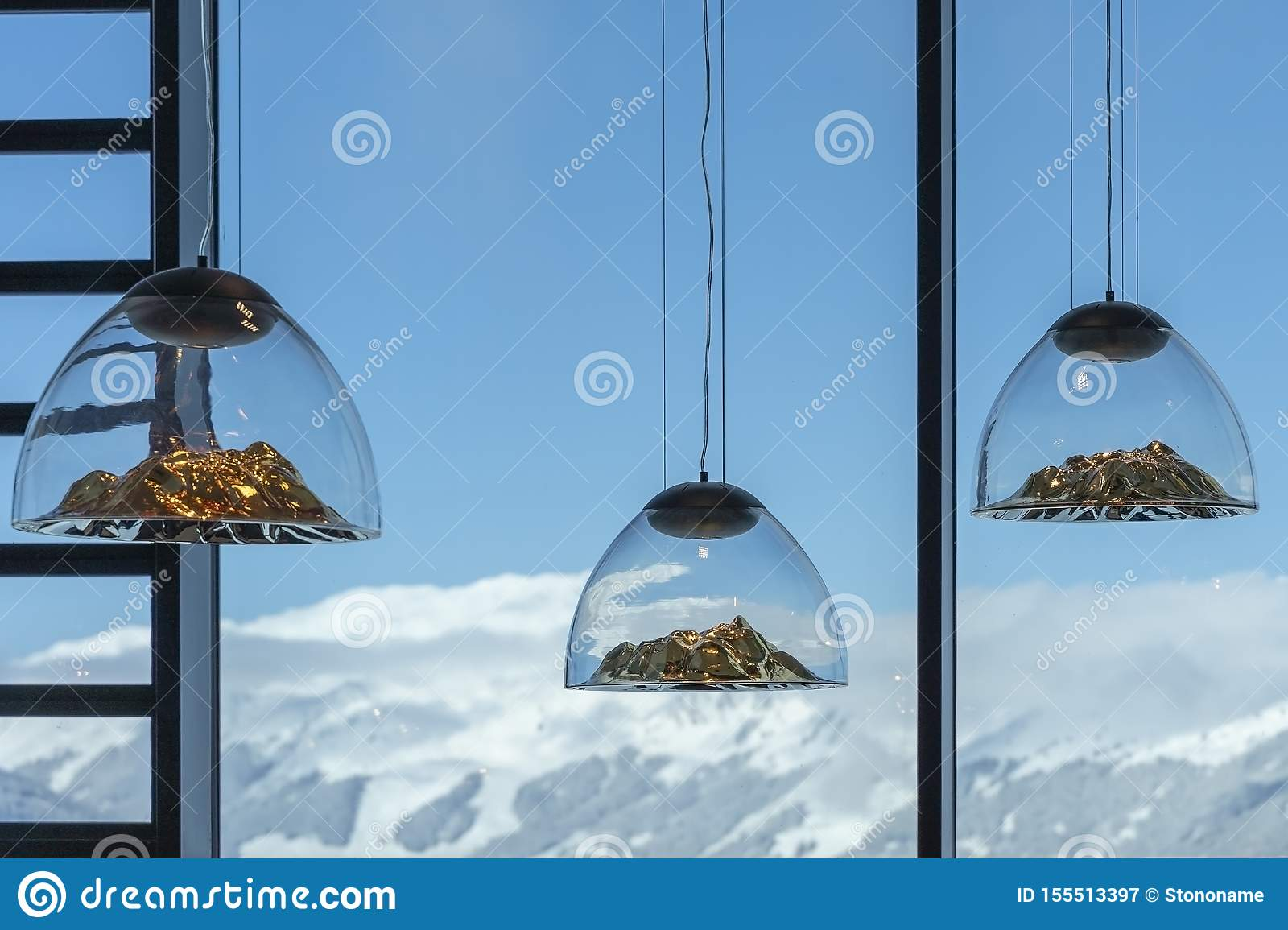 The lamps in shape like mountains in ski resort cafe in Austrian Alps