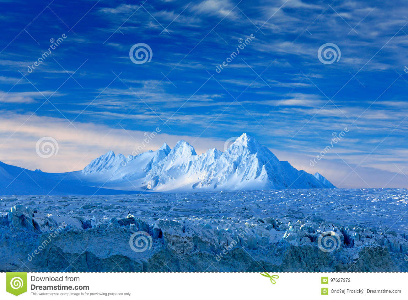 Land of ice. Travelling in Arctic Norway. White snowy mountain, blue glacier Svalbard, Norway. Ice in ocean. Iceberg in North pole