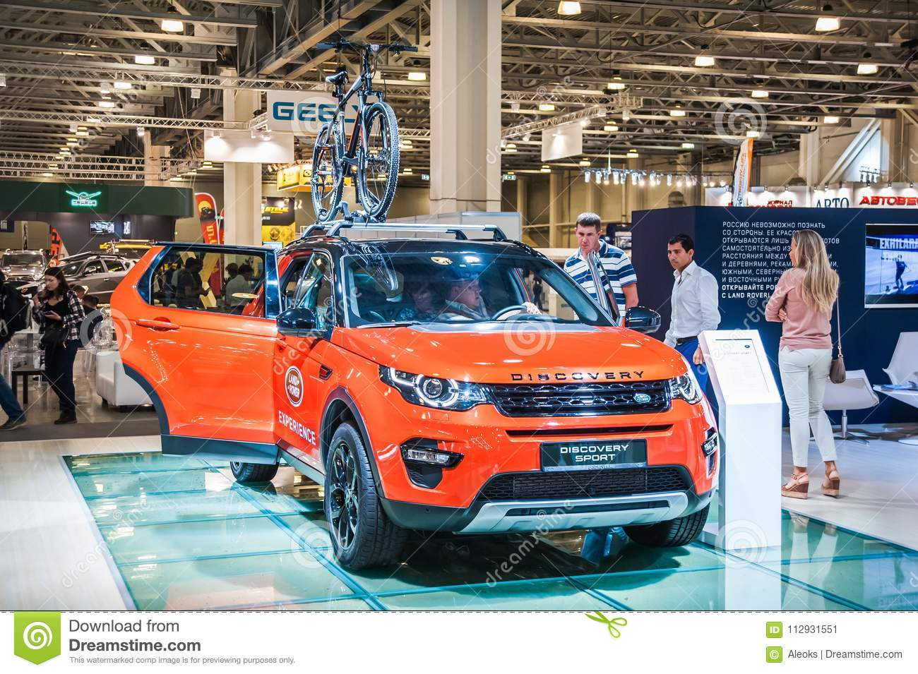 land rover discovery sport with bike on the roof editorial photo