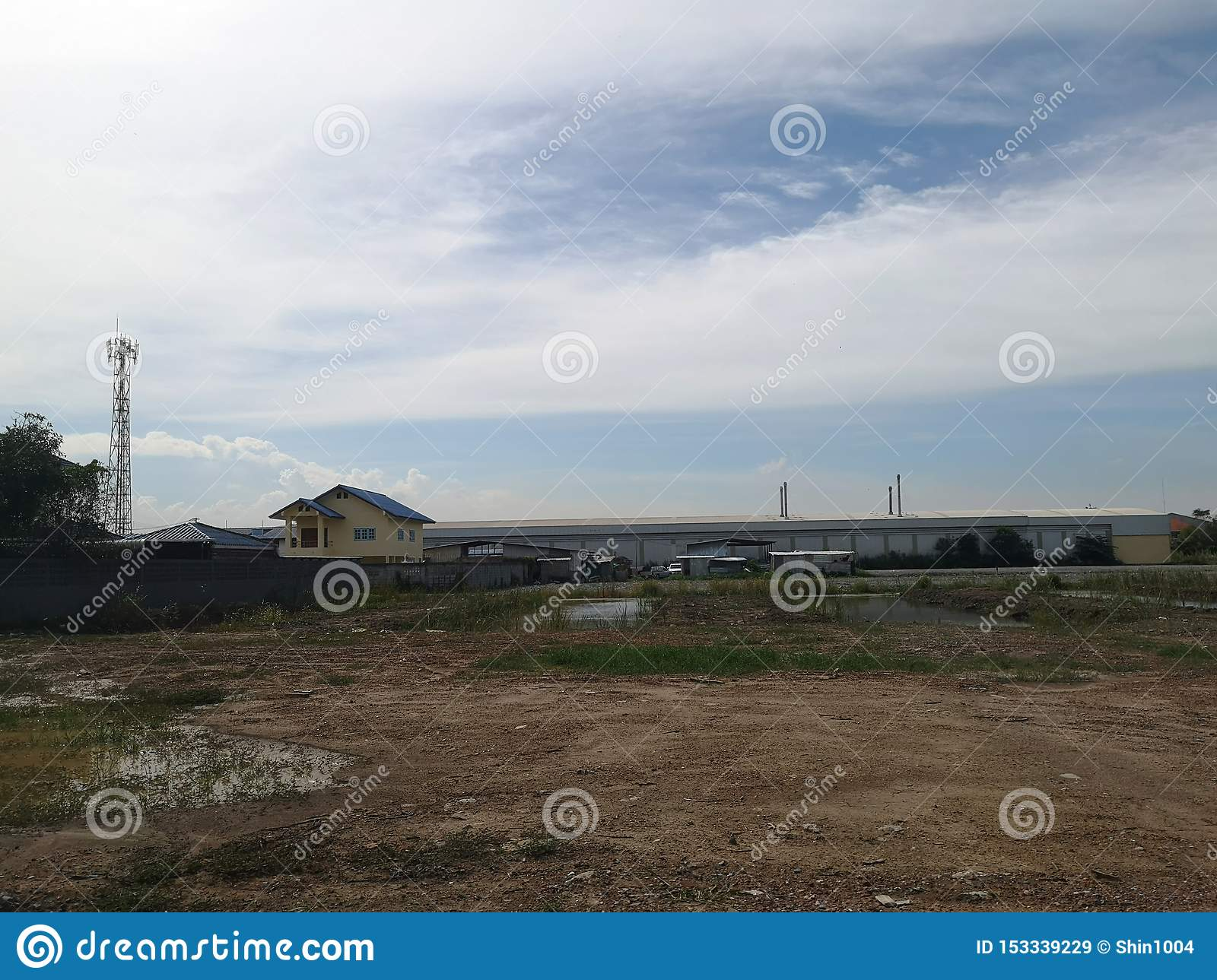 Land for sales concept. Landscape of empty land plot for development, and beautiful blue sky.