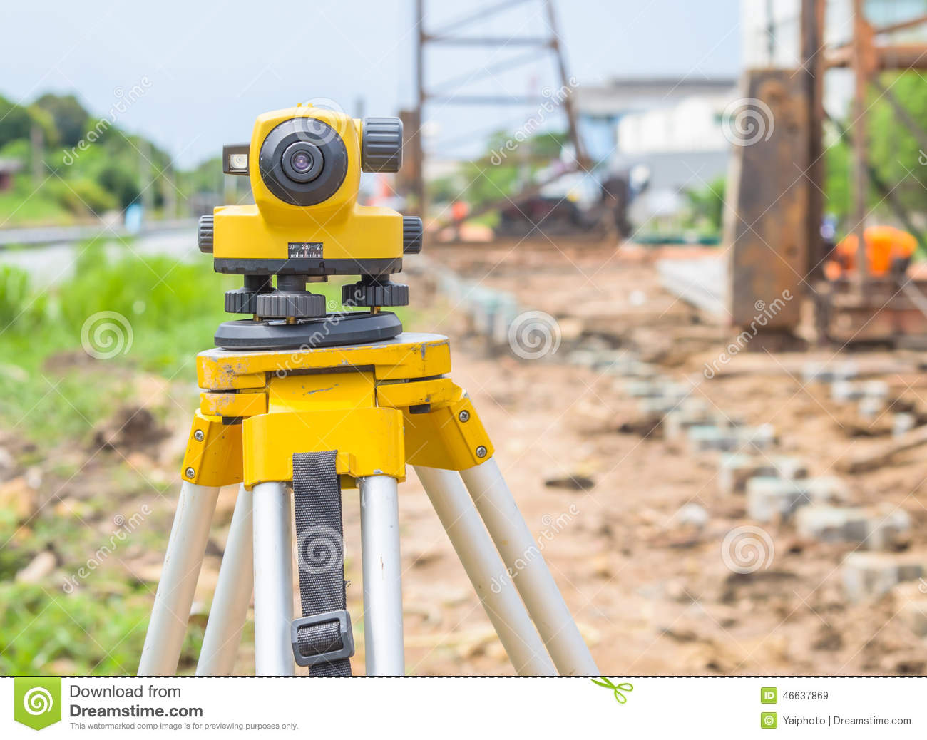 land surveying equipment theodolite at construction site