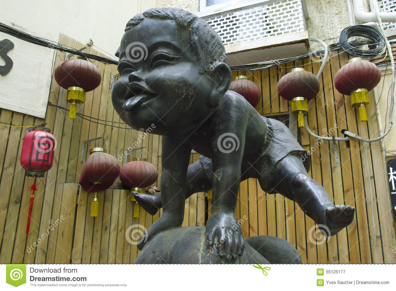 Landmark Little Happy Playing Boy Sculpture of the French Concession in Central Shanghai, China