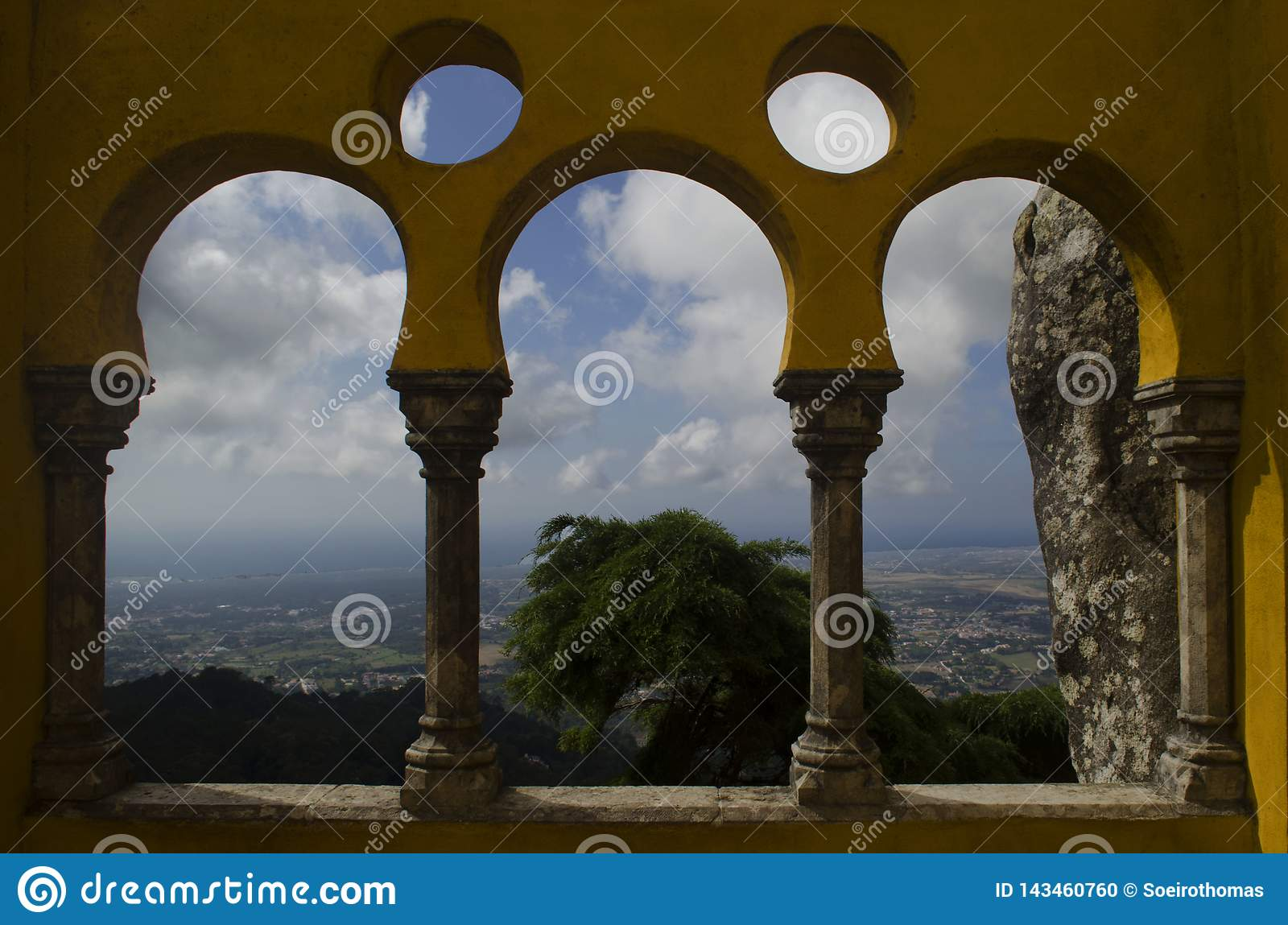 Arches of Pena castle architecture with nature and historic city of sintra