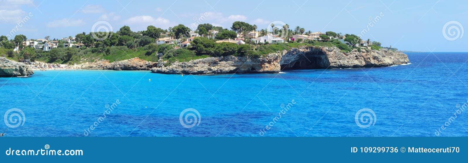 Landscape of the beautiful bay of Cala Anguila with a wonderful turquoise sea, Porto Cristo, Majorca, Spain