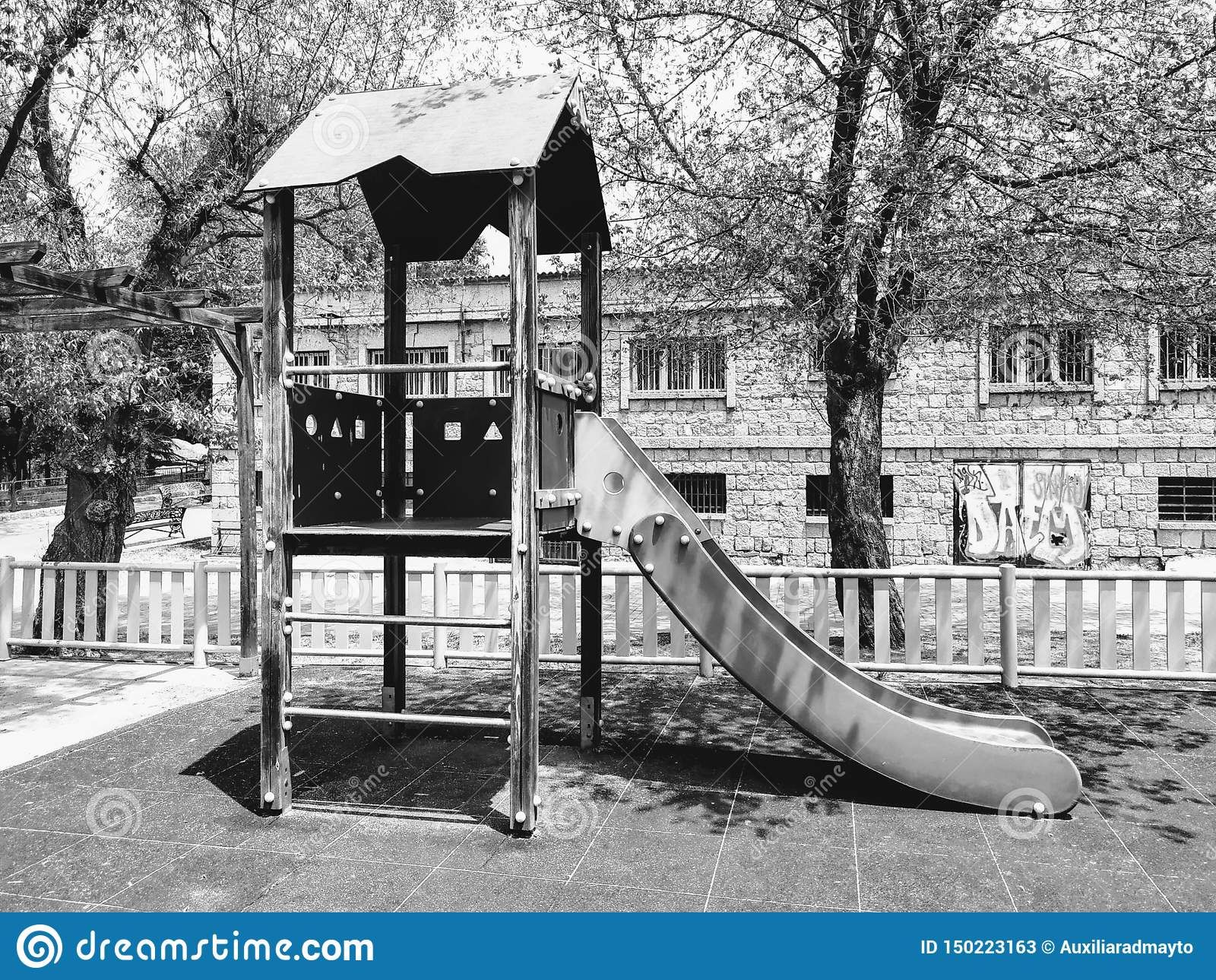 Landscape in black and white. A slide in a park.