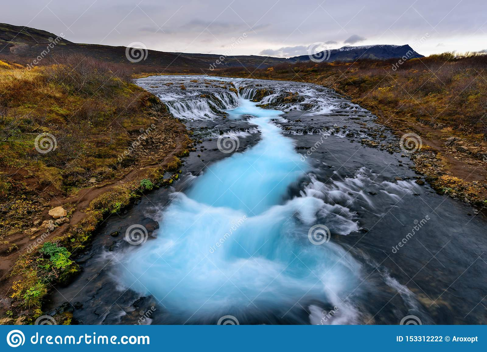 Landscape of Bruarfoss waterfall in Iceland at sunset. Bruarfoss famous natural landmark and tourist destination place. Travel and