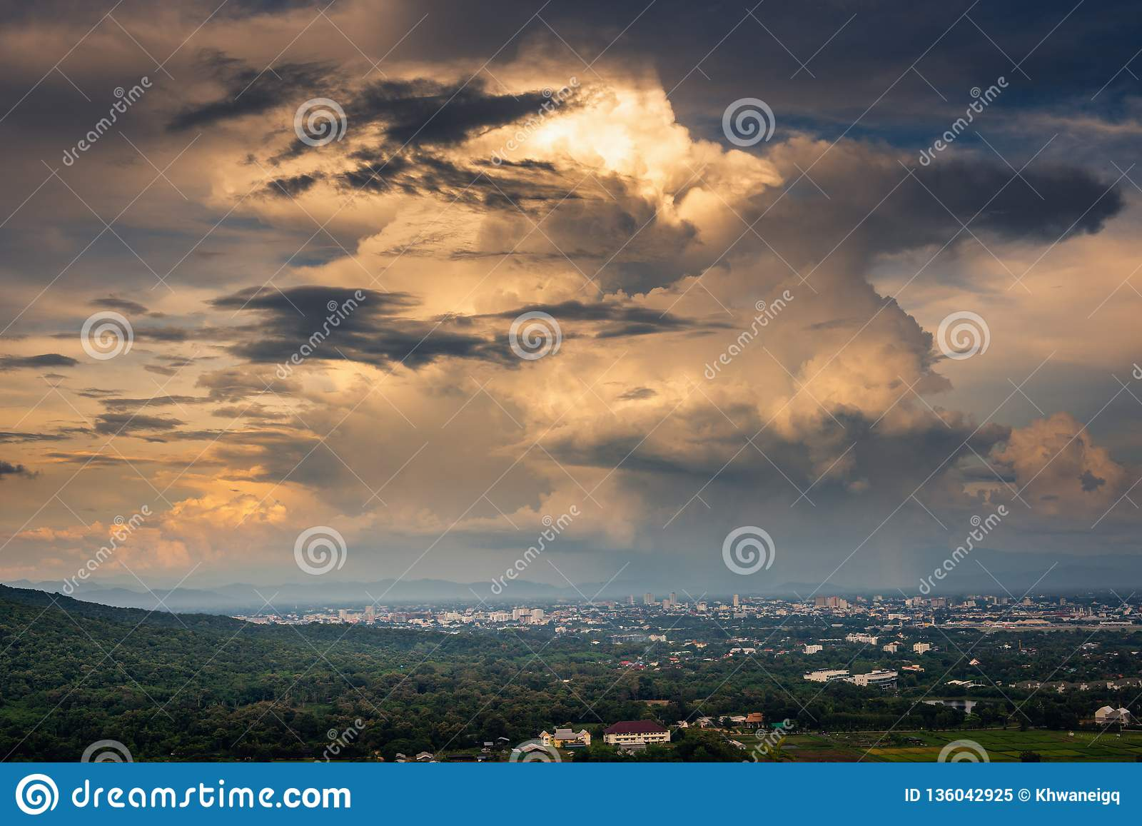 Landscape of dramatic clouds sky over the city at Chiang mai of Thailand., Stormy atmosphere weather situation dramatic at evening
