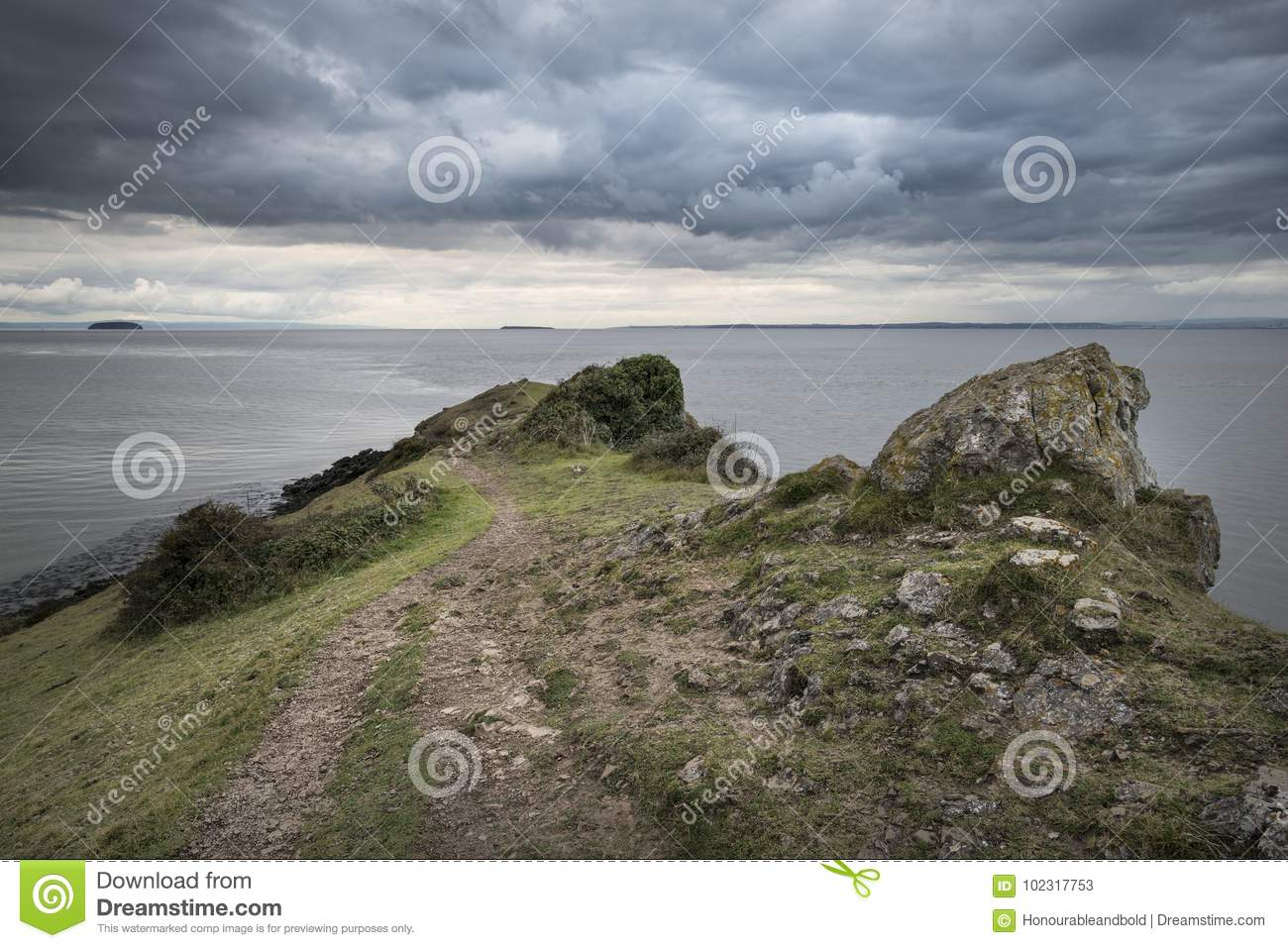 Landscape image looking out to sea with stormy sky
