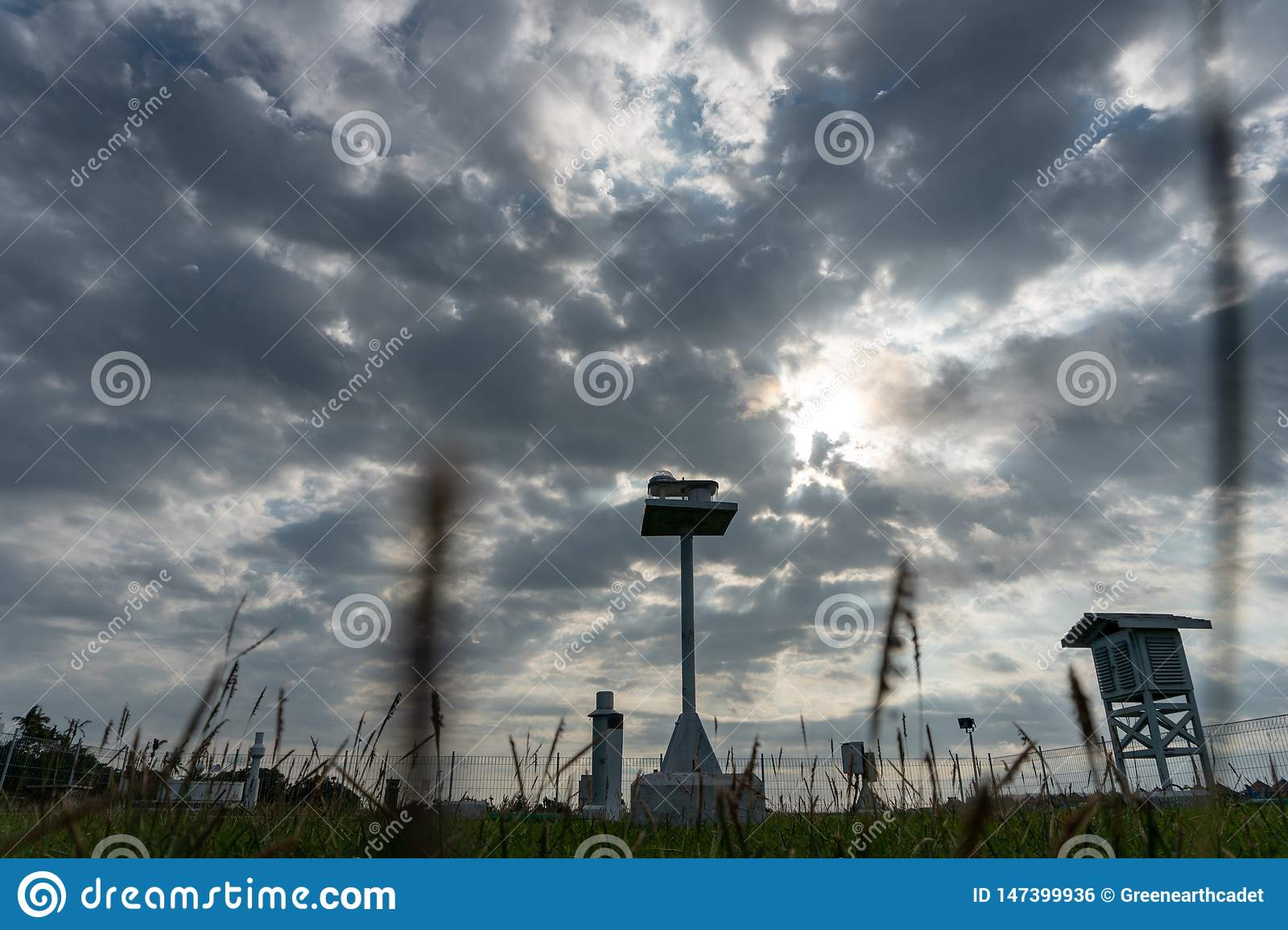A landscape of Meteorological garden in the morning when the sky full grey cumulus and cirrus clouds with beautiful ray of light