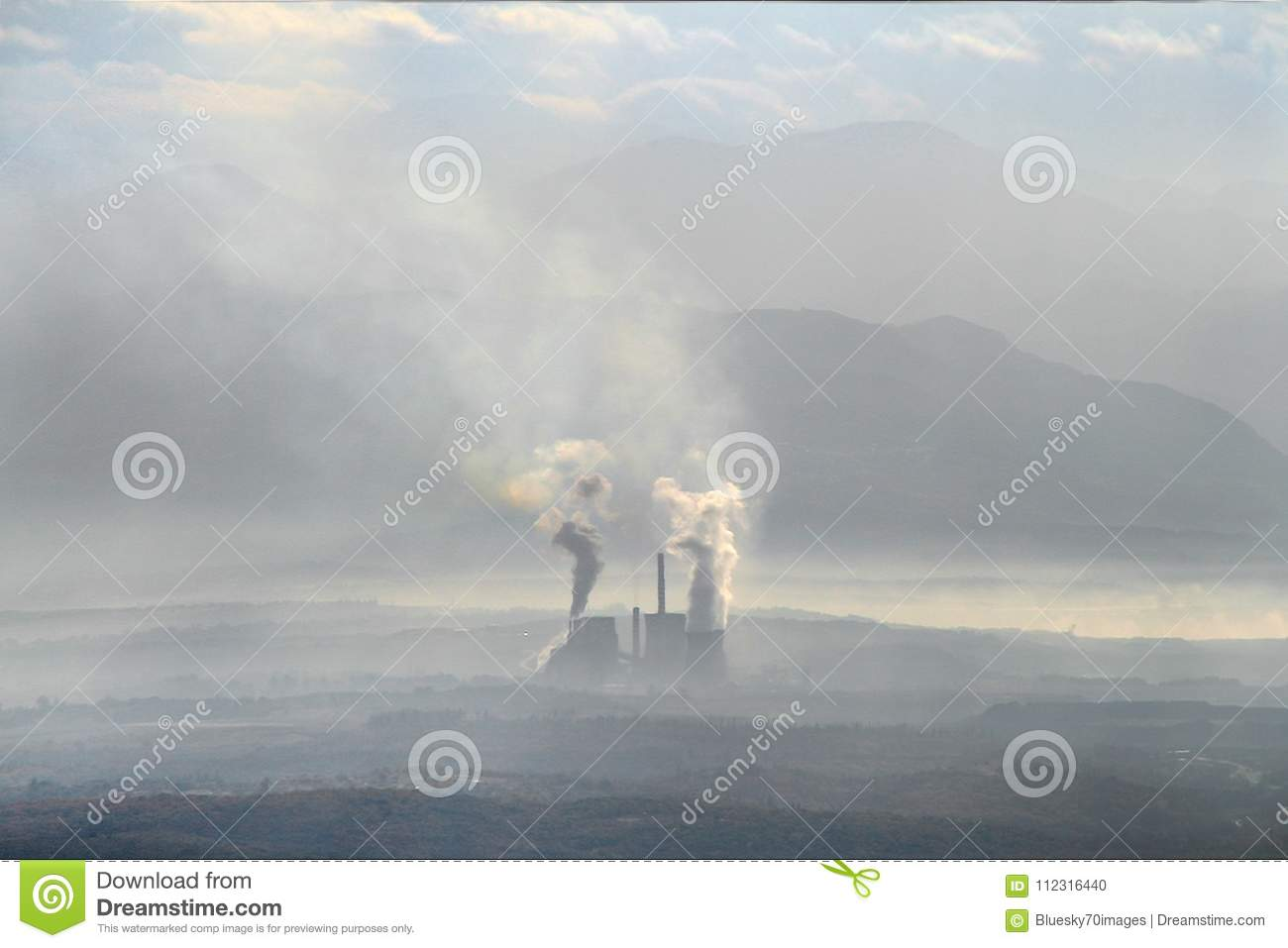 Landscape in mist and pollution. Factory pollutes the atmosphere harmful emissions. Greece