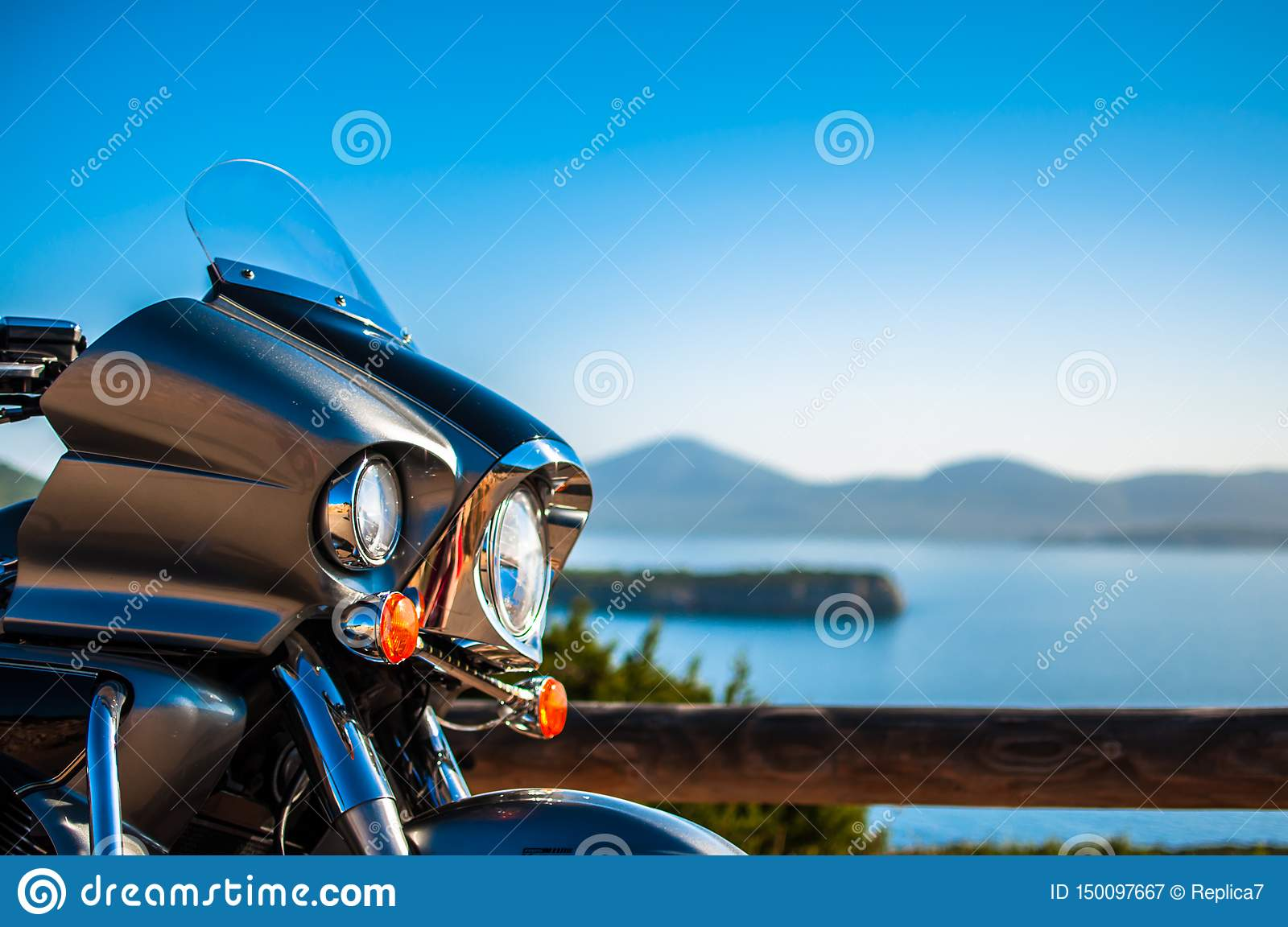 Landscape with a motorcycle on the coast
