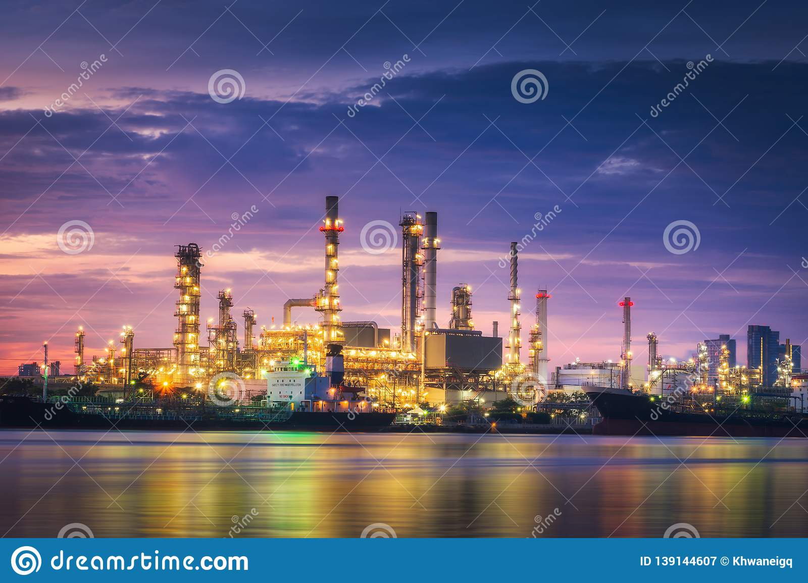 Landscape of oil and gas refinery manufacturing plant., Petrochemical or chemical distillation process buildings., Factory of