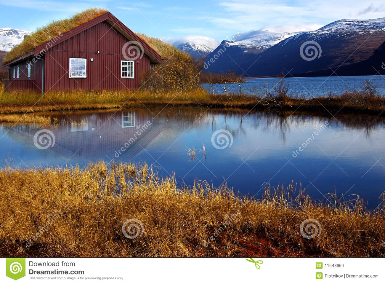 Landscape with old house and lake Stock Photo