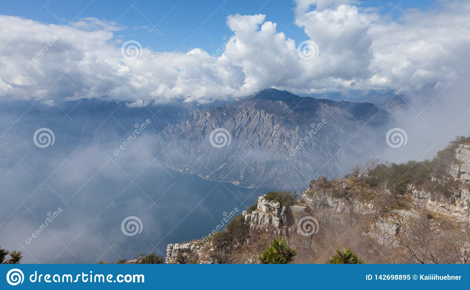 Landscape panorama with clouds on a mountains background over Garda Lake, Veneto region, Italy